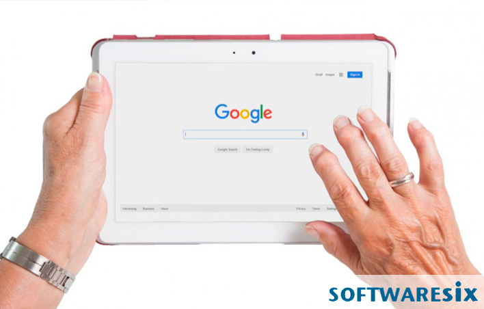 Two hands holding a tablet open to a search engine