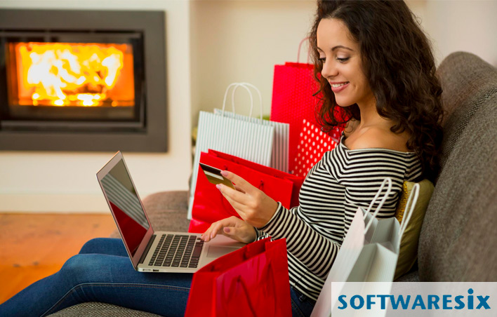 young woman shopping online in her living room